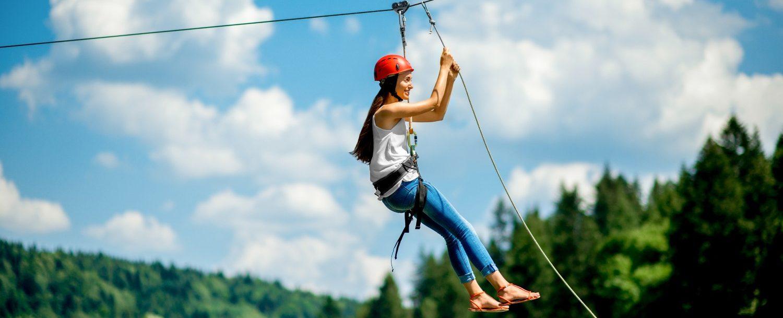 woman ziplining in the poconos