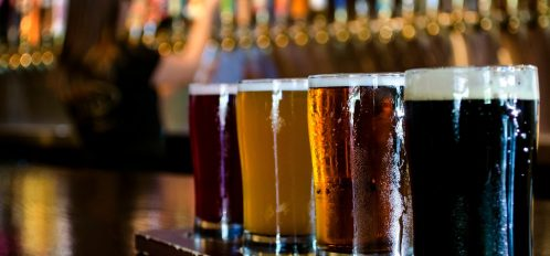 four pints of different beers at a brewery