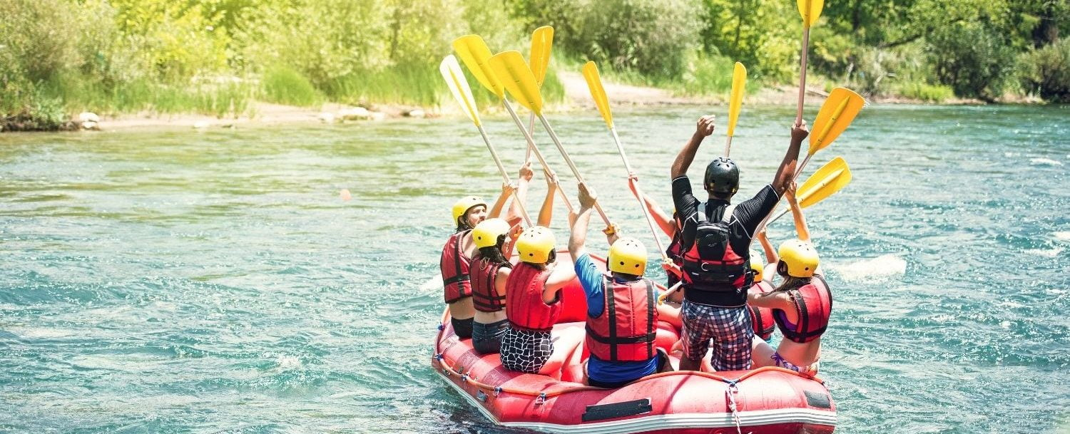 People on a white water raft.