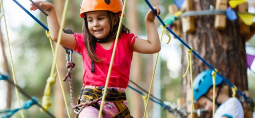 girl climbing on rope course