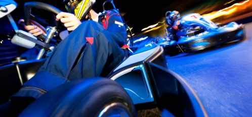 people driving in go karts