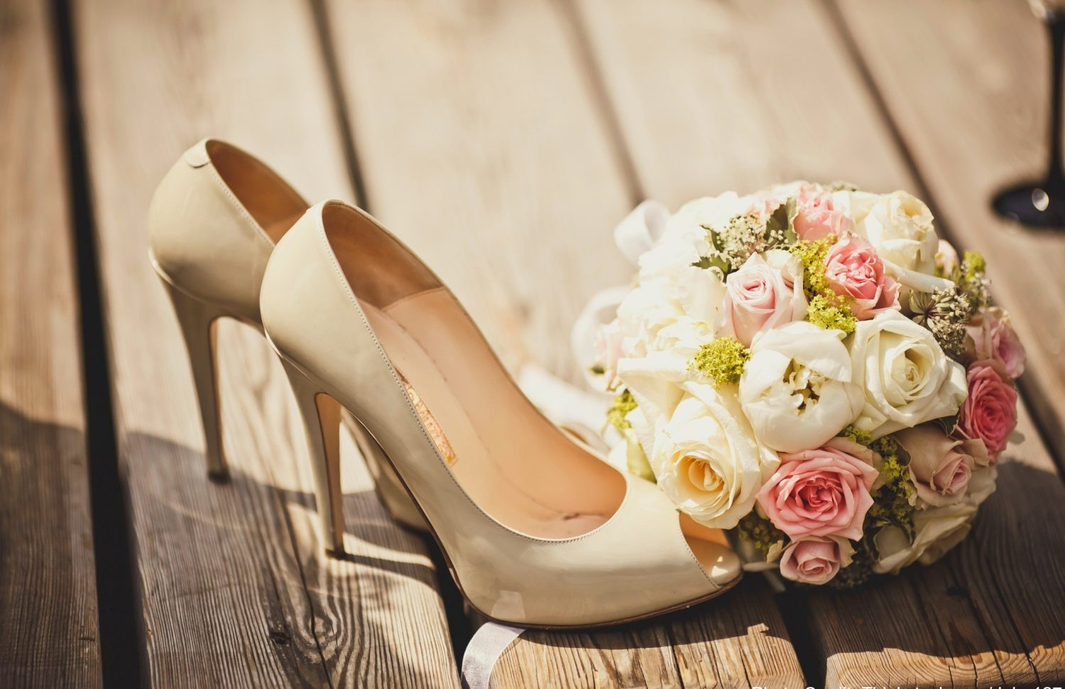 wedding shoes and floral bouqet