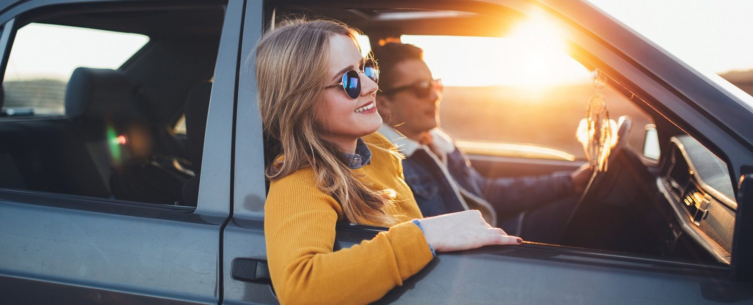 Young hipster couple enjoy sunset roadtrip