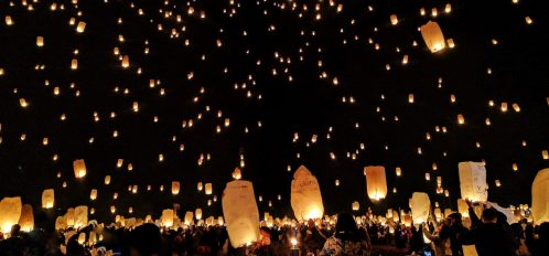 People release lanterns into the night sky