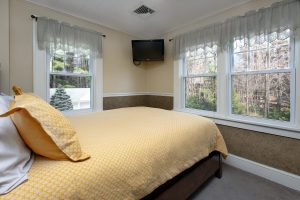 View of bed in Poconos Room.