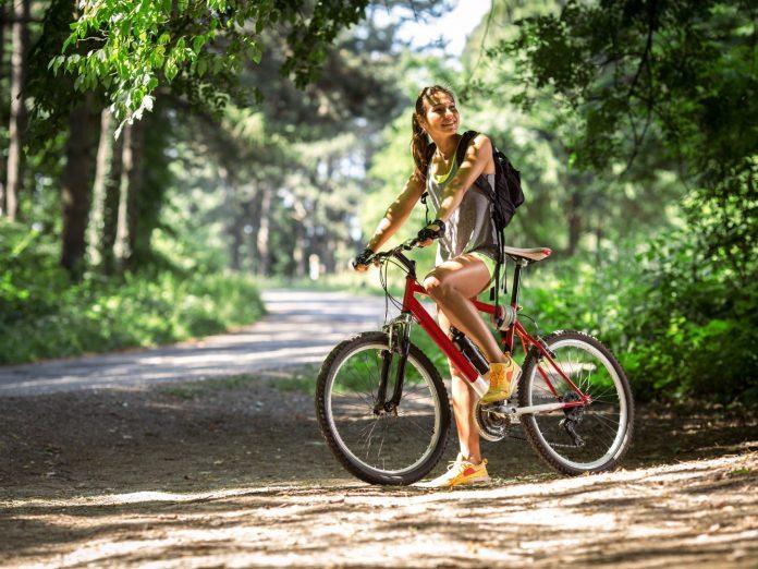 Woman on a bike trail.