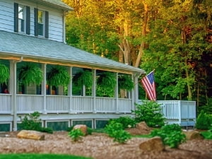 Mountaintop Lodge at Lake Naomi large porch with American flag